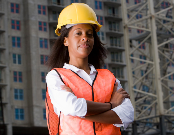 woman in hard hat and hi vis jacket