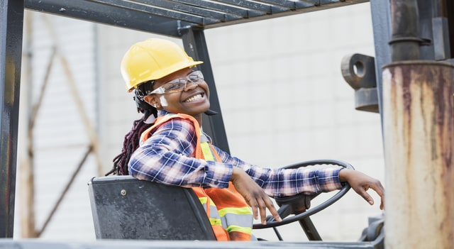 Smiling woman on forklift