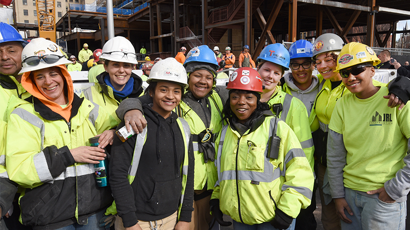 A group of young people on a construction site